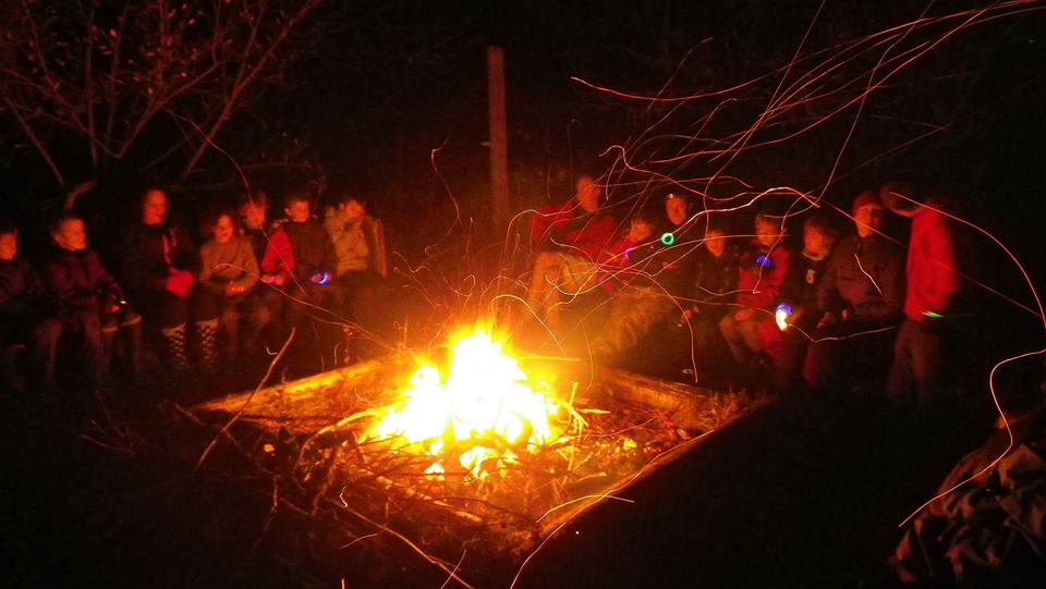 Cubs singing round the fire!